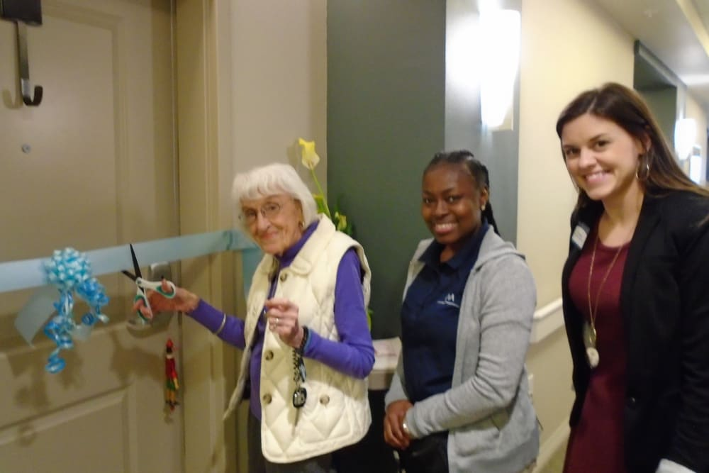 Resident cutting ribbon to her new apartment at Merrill Gardens at Carolina Park in Mount Pleasant, South Carolina.