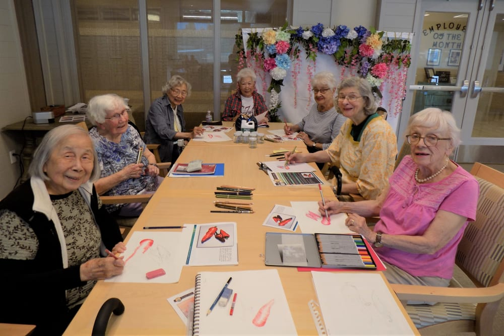 Residents work on their colored pencil technique with Janice at Monterey