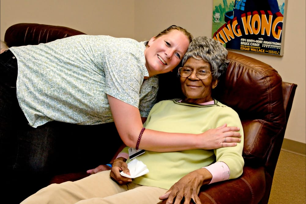 A staff member hugging a resident at Patriots Landing in DuPont, Washington.