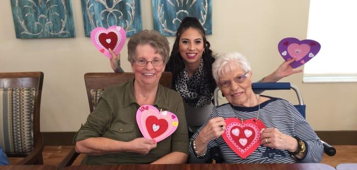 Senior residents enjoying Valentines day crafts