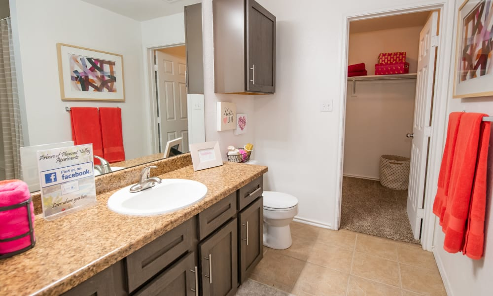 An apartment bathroom at Arbors of Pleasant Valley in Little Rock, Arkansas