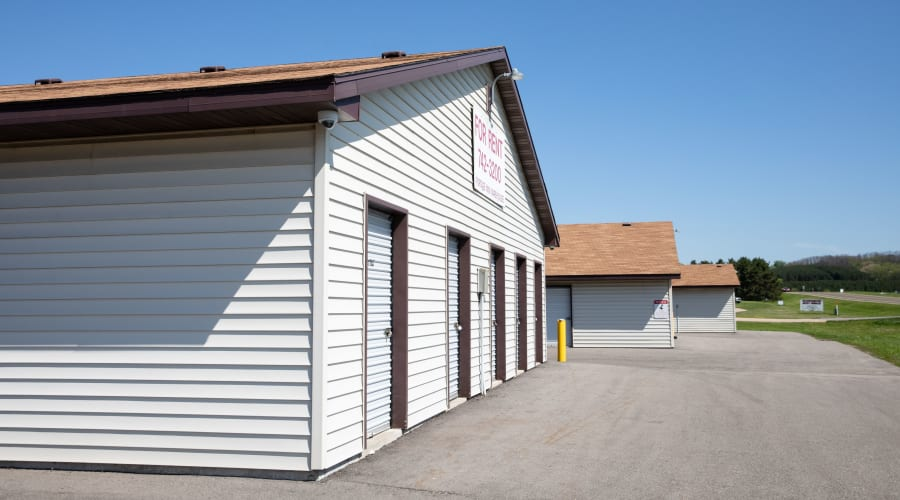 Exterior view of storage units with white doors at KO Storage of Portage - North in Portage, Wisconsin