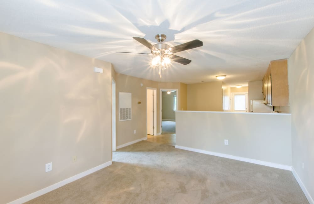 Spacious living room with a ceiling fan at Wexford Apartment Homes in Charlotte, North Carolina