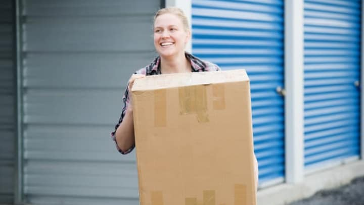 Woman carrying a box at {{location_name}}