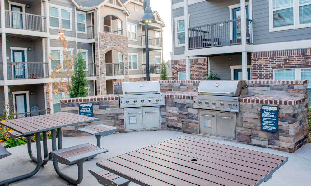 Grilling area next to pool with tables to use at Artisan Crossing in Norman, Oklahoma
