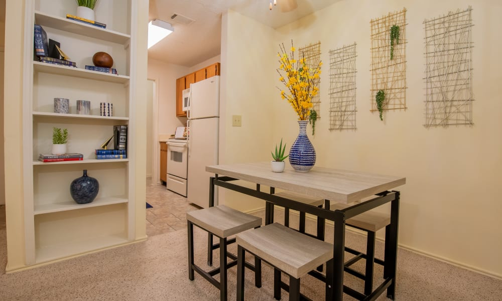 Bright dining room and kitchen at Newport Apartments in Amarillo, Texas