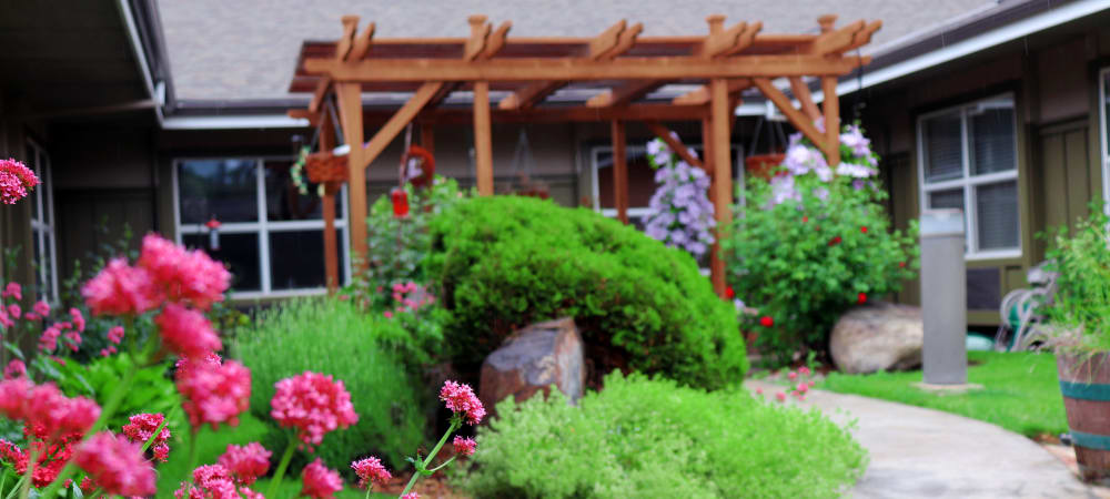 Green space complete with flowers and lush landscaping at The Springs at Mill Creek in The Dalles, Oregon