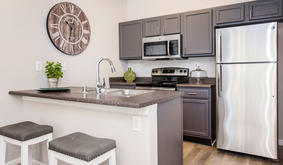 A spacious kitchen with an island at Southgate Landing in Louisville, Kentucky