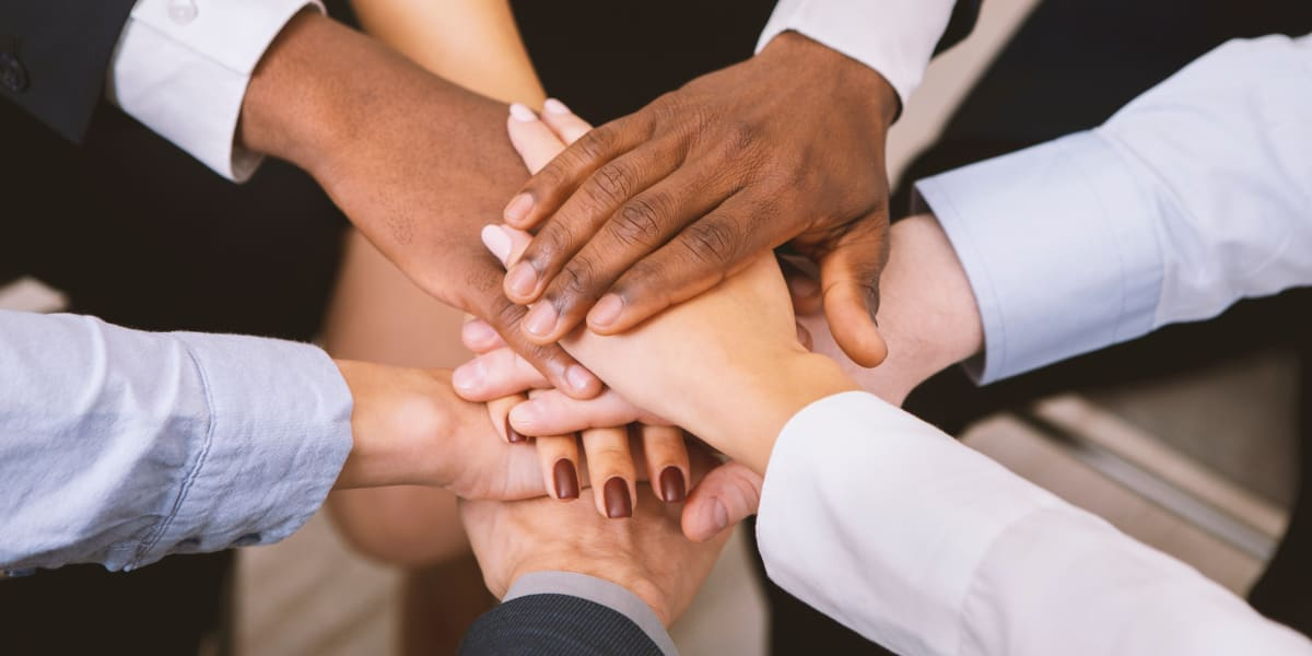 Employee hands in at Coast Property Management in Everett, Washington