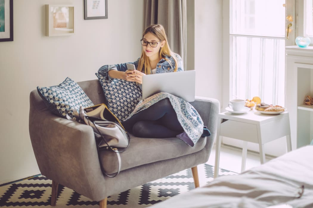 Woman working from home at Cottages at Abbey Glen Apartments in Lubbock, Texas