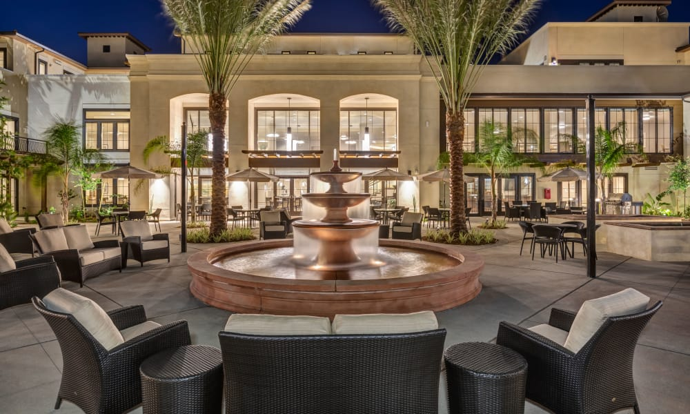 Outdoor patio with cozy furniture at Merrill Gardens at Rancho Cucamonga in Rancho Cucamonga, California.