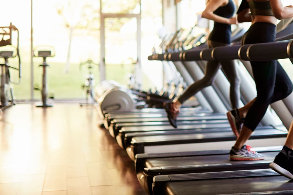 Residents running on treadmill at Cahaba Grandview in Birmingham, Alabama
