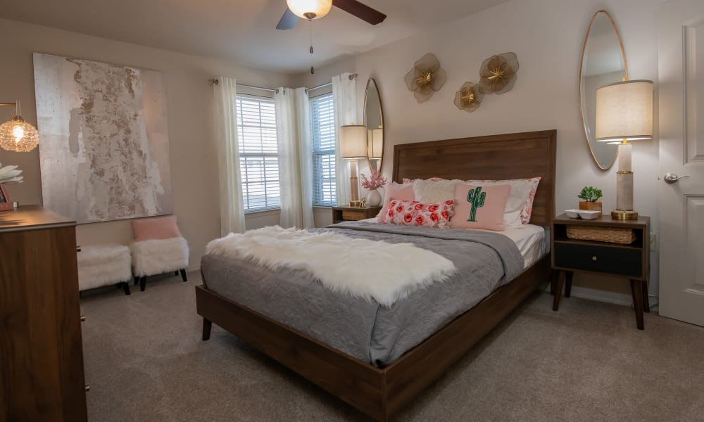 Spacious bedroom with ceiling fan at Portico at Friars Creek Apartments in Temple, Texas