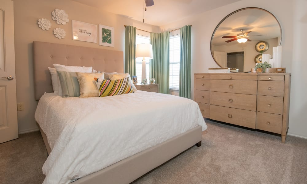 Bright, spacious bedroom at Portico at Friars Creek Apartments in Temple, Texas