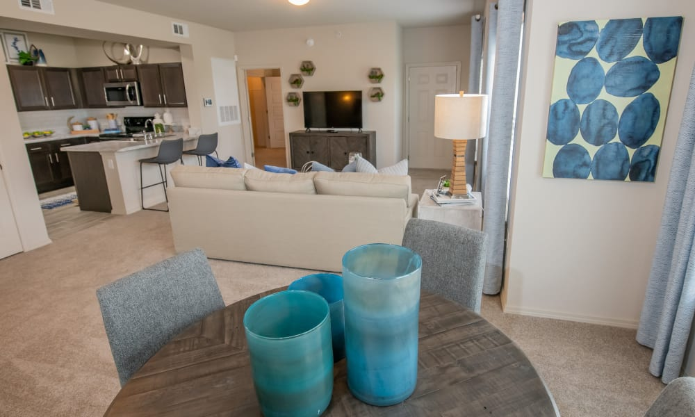 Loft apartment living, dining and kitchen at Bend at New Road Apartments in Waco, Texas