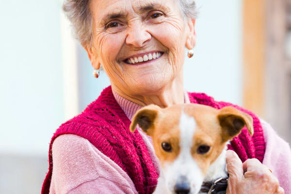 Resident holding her dog at Bayberry Commons in Springfield, Oregon