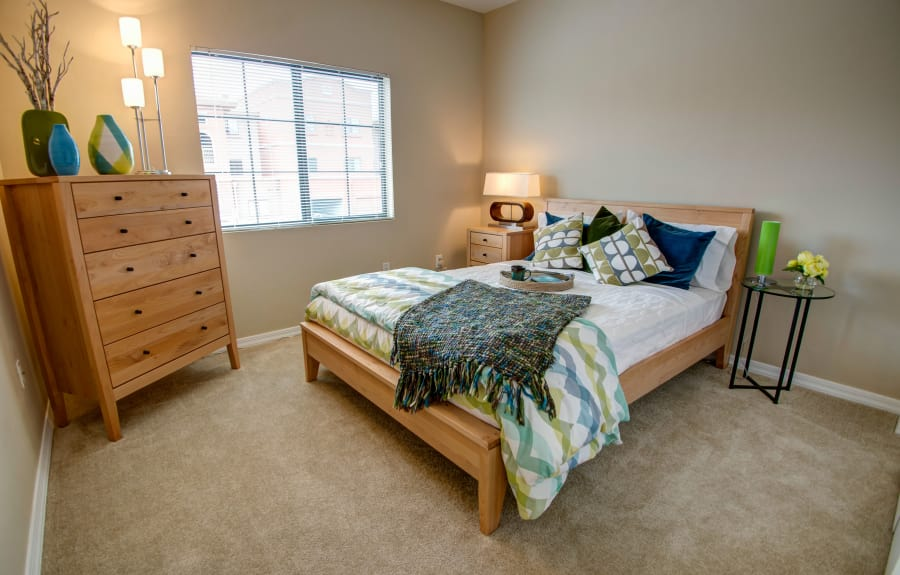Cute model bedroom at Oro Vista Apartments in Oro Valley, Arizona
