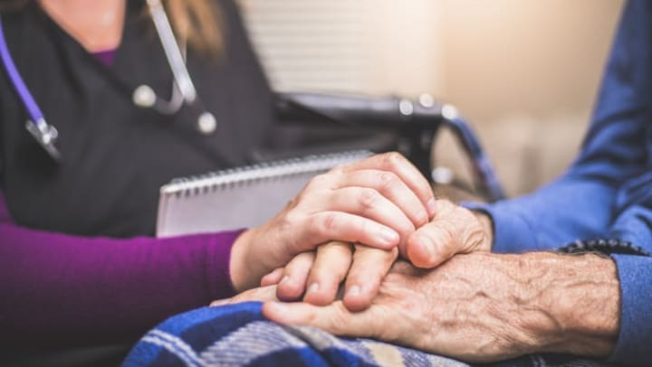 A nurse visiting a patient who is receiving care