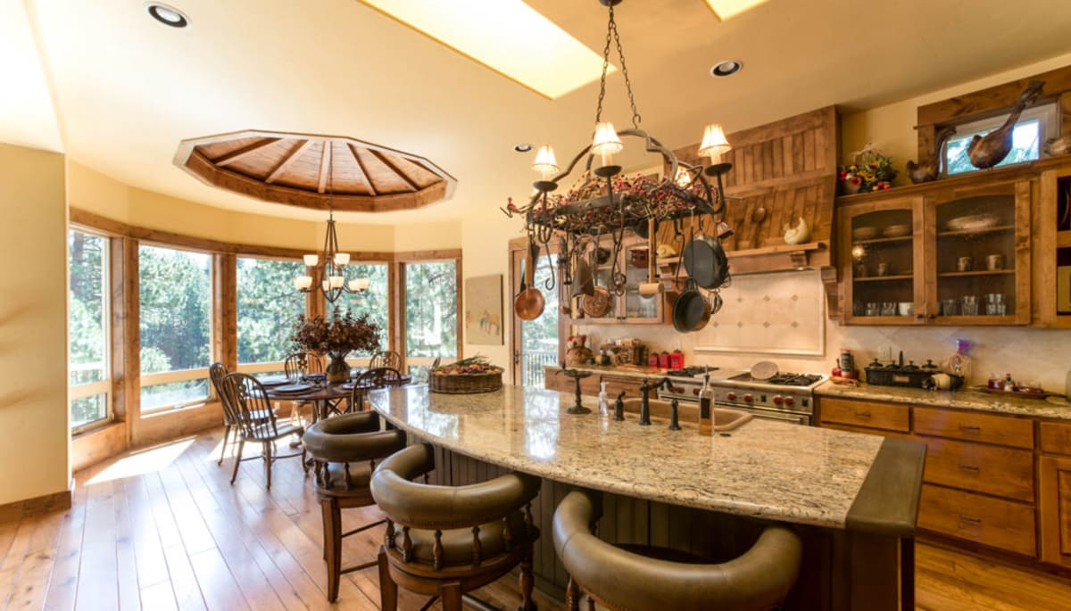 Bar seating in an upgraded cottage kitchen at Touchmark at Mount Bachelor Village in Bend, Oregon