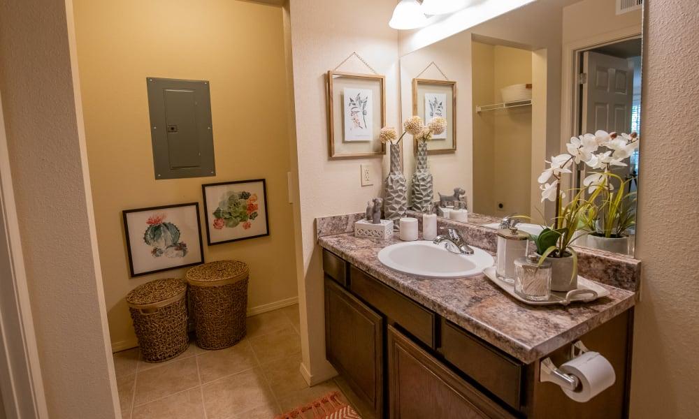 A comfy bathroom with laundry at Tuscany Hills in Tulsa, Oklahoma