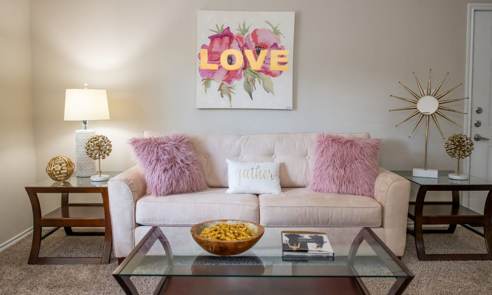 An apartment living room at Arbors of Pleasant Valley in Little Rock, Arkansas