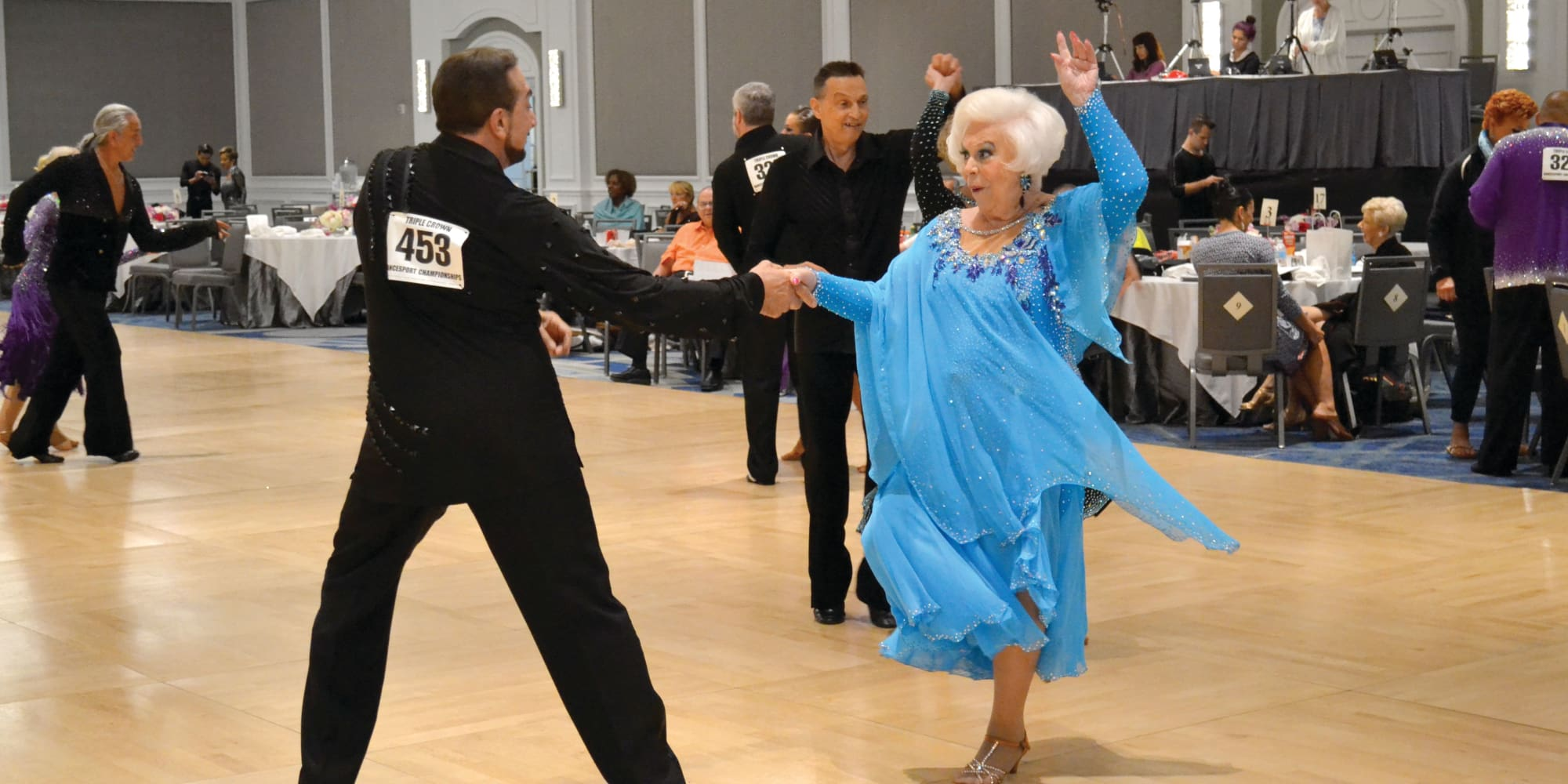 Two residents dancing for a competition at Cypress Springs Gracious Retirement Living in Bradenton, Florida