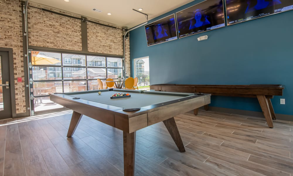 Pool table and shuffle board for resident use at Cottages at Crestview in Wichita, Kansas