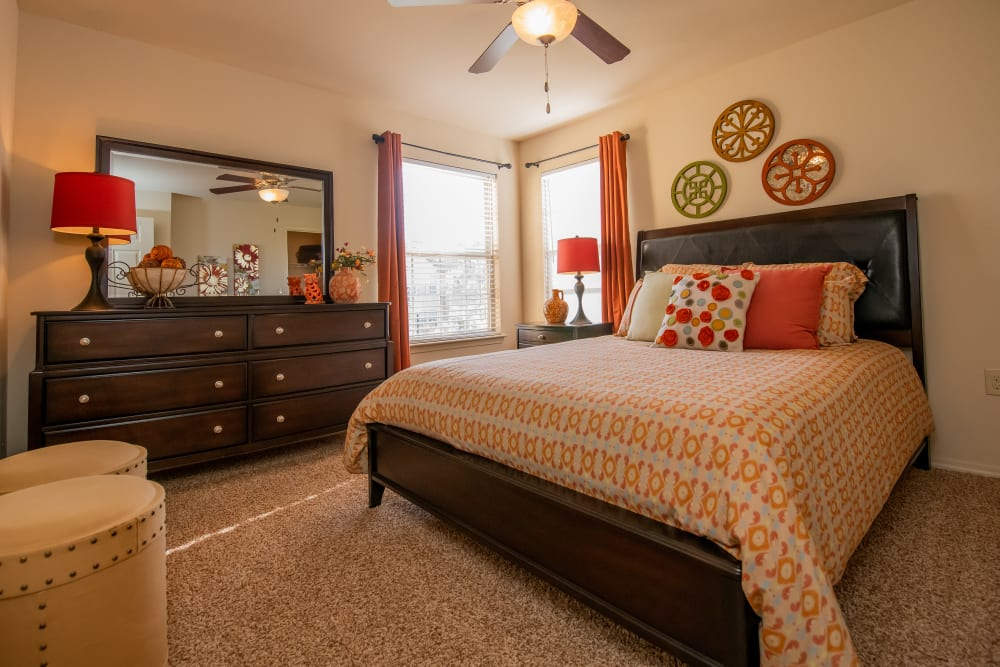 Bright, carpeted bedroom at Park at Tuscany in Oklahoma City, Oklahoma