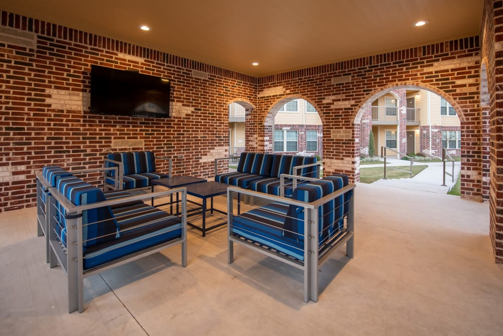 Cabana seating and lounge at Portico at Friars Creek Apartments in Temple, Texas