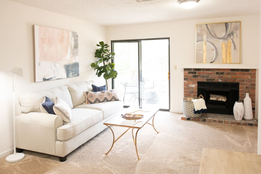 Living room with fireplace at The Mark Apartments in Ridgeland, Mississippi