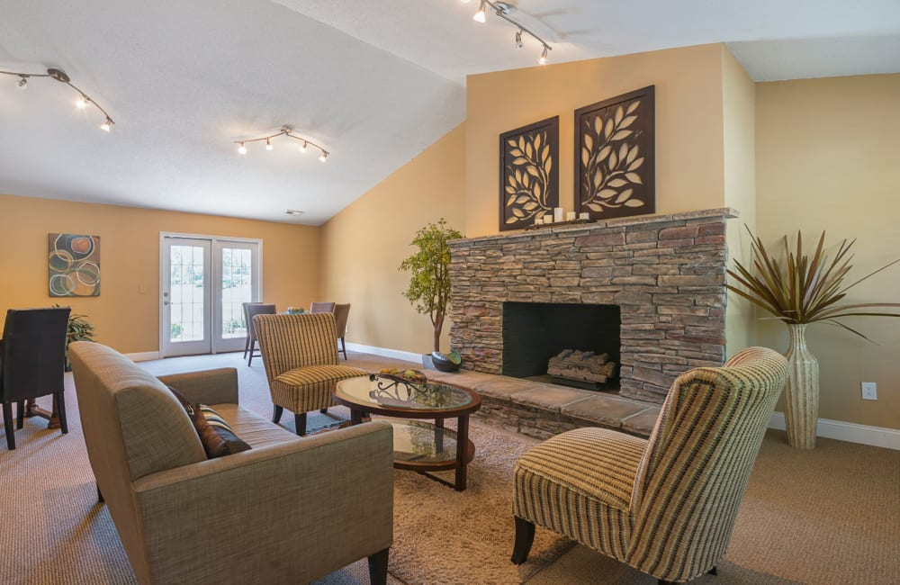 A rustic clubhouse with a large fireplace at Lakewood Apartment Homes in Salisbury, North Carolina