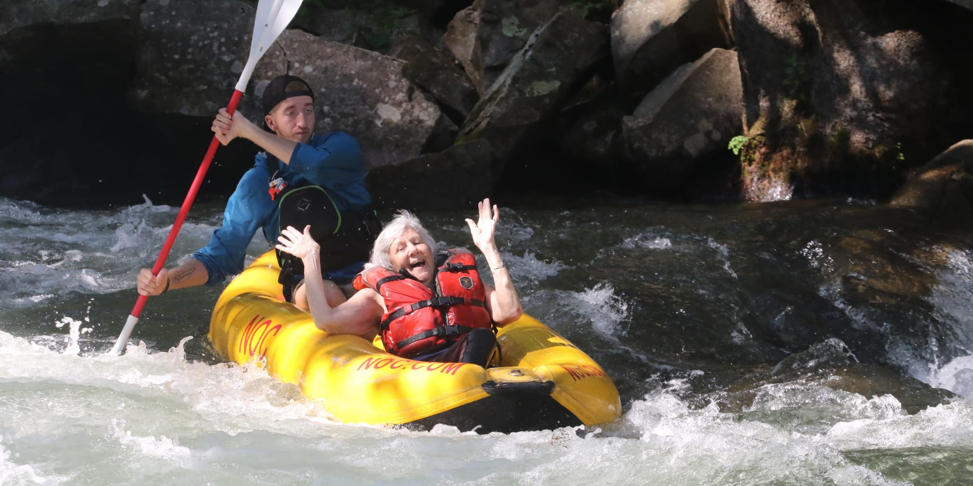 A happy resident from Bella Vista Gracious Retirement Living in Asheville, North Carolina, whitewater rafting