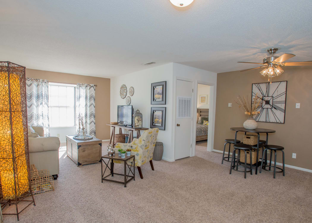 Open-concept living area in model home at The Greens of Bedford in Tulsa, Oklahoma