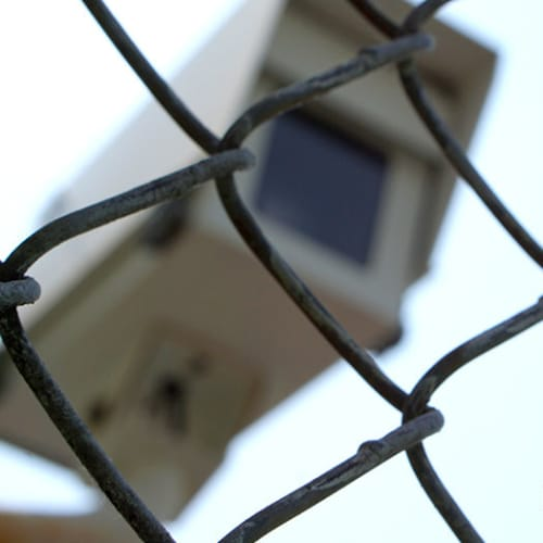 Security camera behind a chain link fence at Red Dot Storage in Woodstock, Illinois