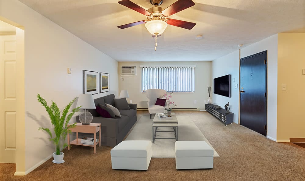 Spacious living room with a ceiling fan at Westpointe Apartments in Pittsburgh, Pennsylvania