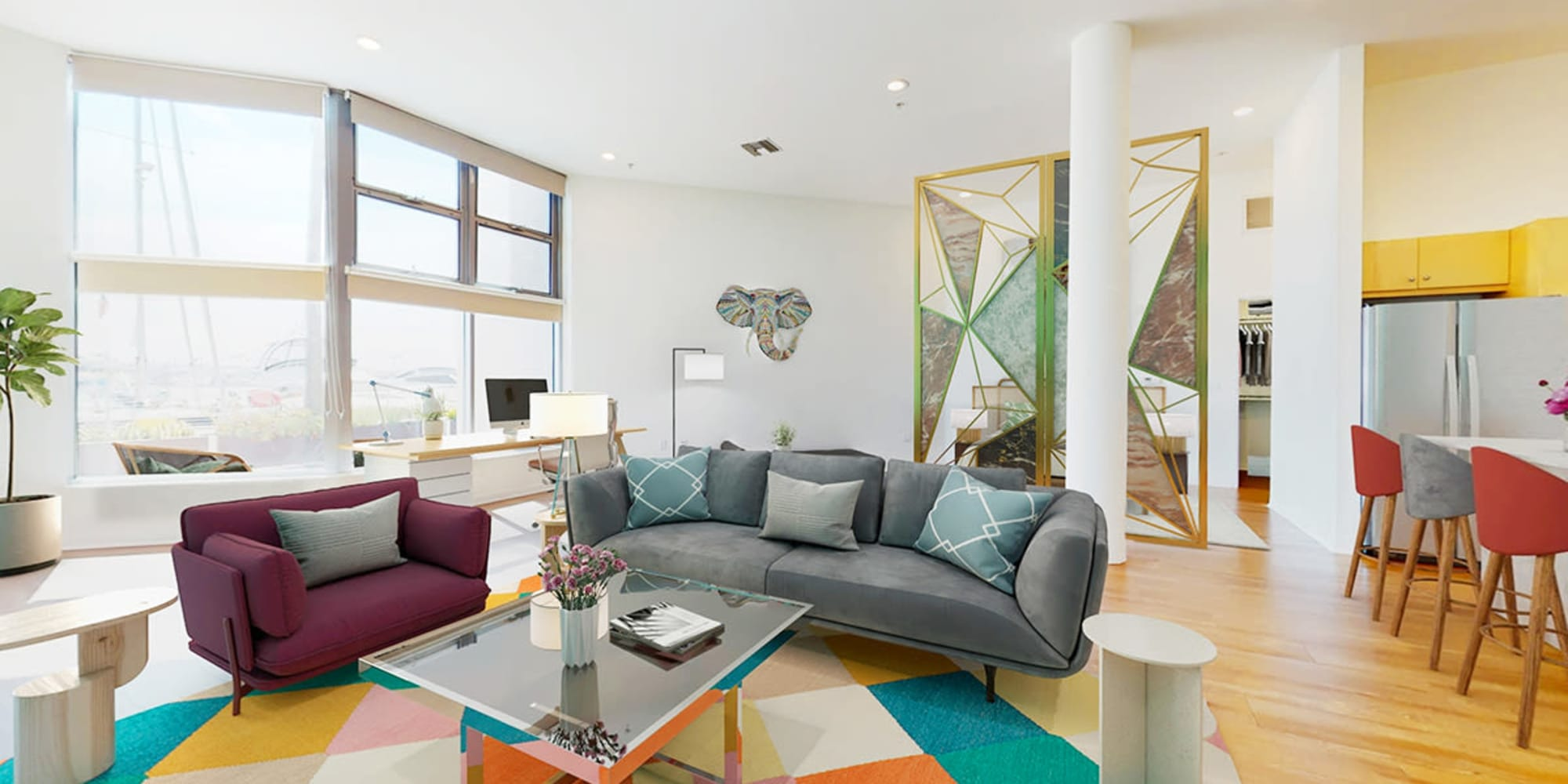 Spacious loft apartment's living room with waterfront views and hardwood floor at Esprit Marina del Rey in Marina Del Rey, California