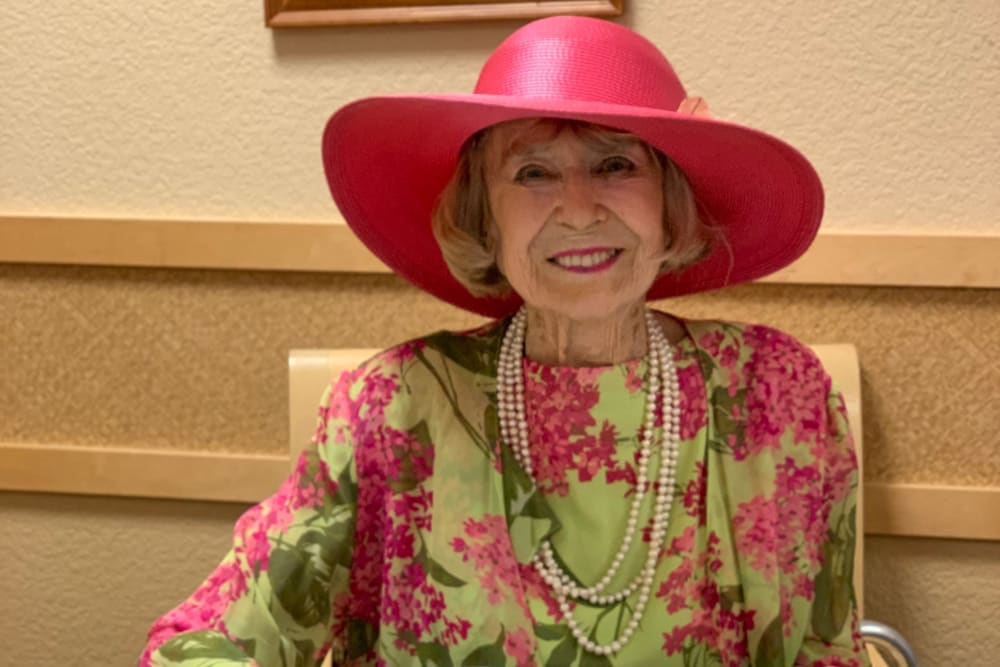 A happy resident at Merrill Gardens at Willow Glen in San Jose, California.