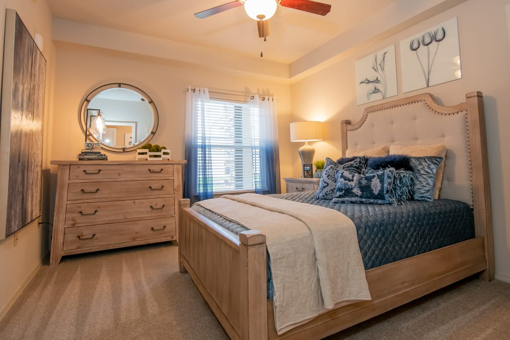 Well-lit bedroom at Stonehorse Crossing Apartments in Oklahoma City, Oklahoma