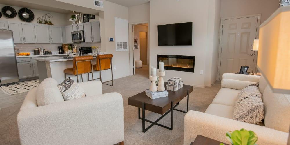 Stunning living room with plush carpet at 97@ North Oak in Kansas City, Missouri