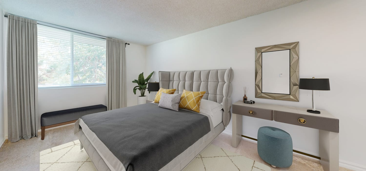 Spacious bedroom inside a two-bedroom apartment at Sunset Barrington Gardens in Los Angeles, California