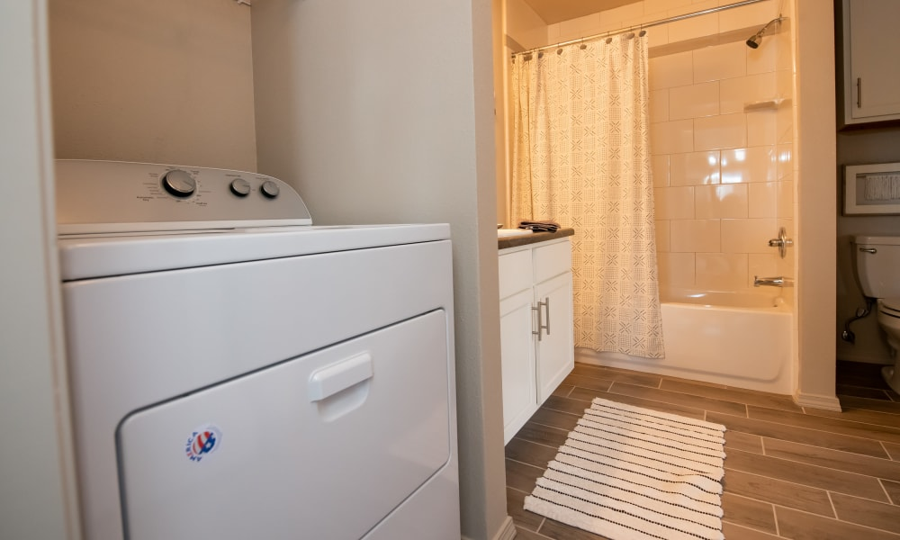 Bathroom with laundry at Portico at Friars Creek Apartments in Temple, Texas