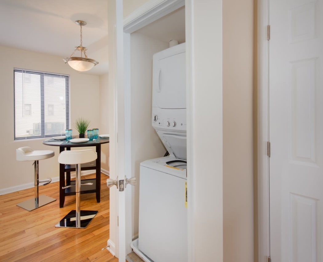 In-unit laundry and breakfast nook in the background in model home at The Residences at Silver Hill in Suitland, MD