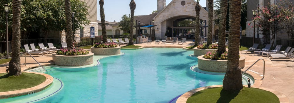 A resort-style swimming pool at Sommerall Station Apartments in Houston, Texas
