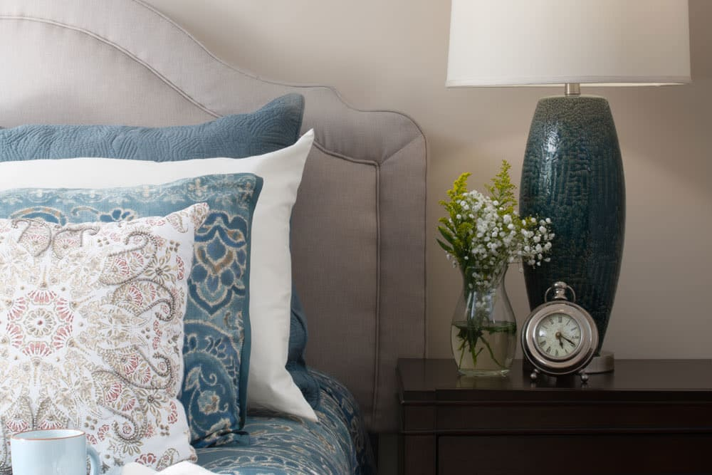 bed with nightstand and vase