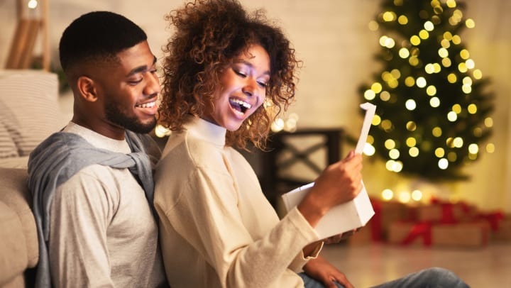 Man and woman open a present