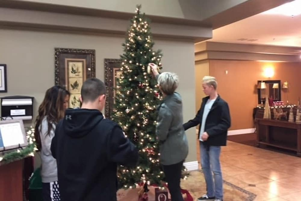 Decorating the tree at Merrill Gardens at Siena Hills in Henderson, Nevada.