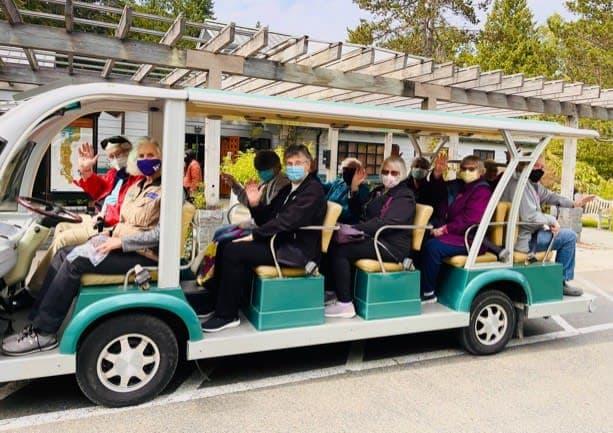 Ballard residents embark on the tram for a fun-filled tour of the University of Washington Botanical Gardens.