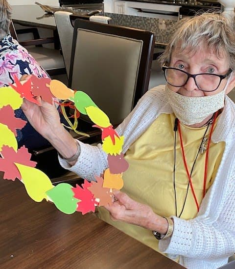 Arbour Square residents showed off their colorful leaf wreaths.
