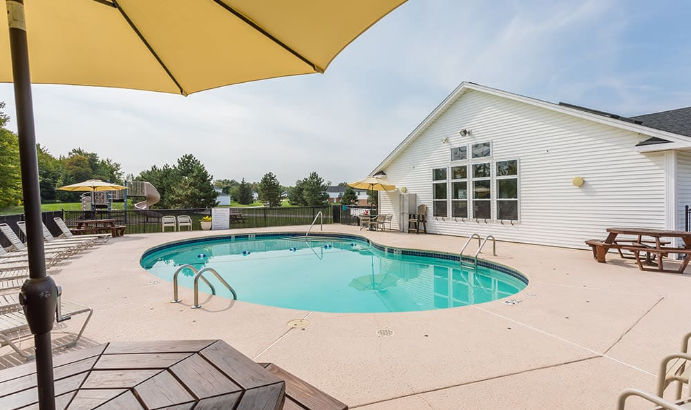 Resort-style swimming pool at Green Lake Apartments & Townhomes in Orchard Park, New York