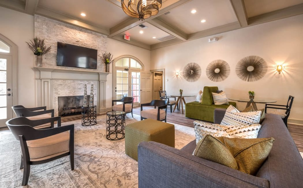 Comfortable seating and beautiful surroundings in the resident clubhouse at Kenwood Club at the Park in Katy, Texas